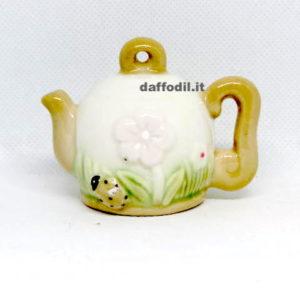 Teiera con fiore in porcellana